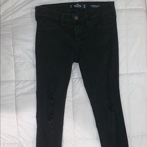 black ripped low rise jean legging